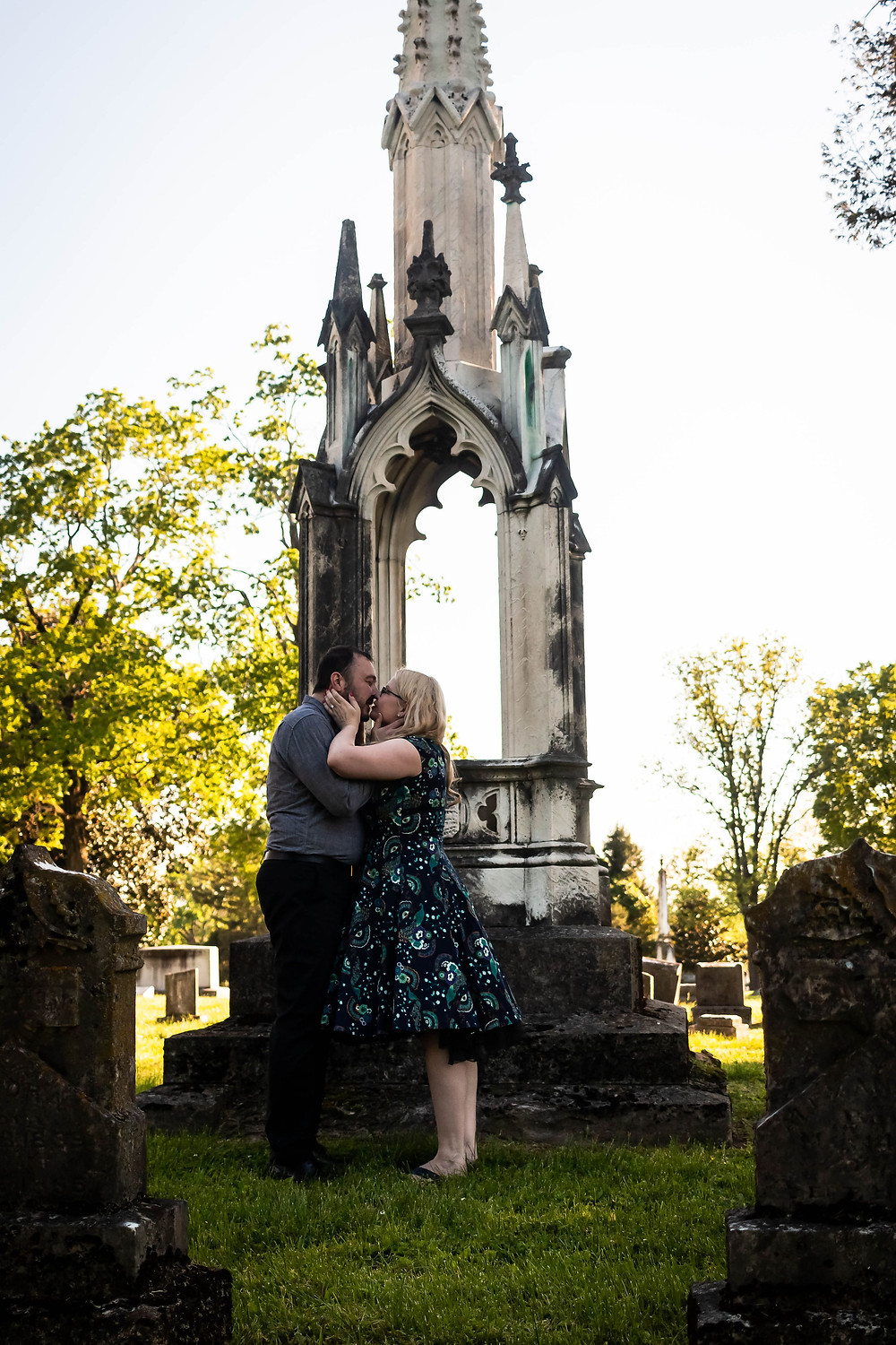 Cute couple share a kiss in cemetery at Mt. Olivet Cemetery