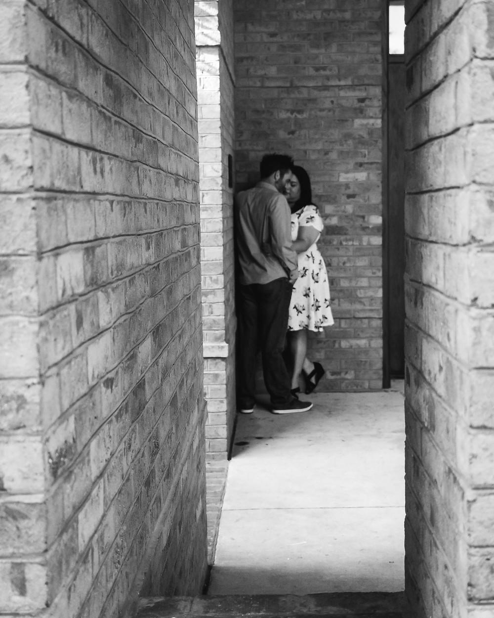 Black and white cute couple share a secret moment in downtown Murfreesboro