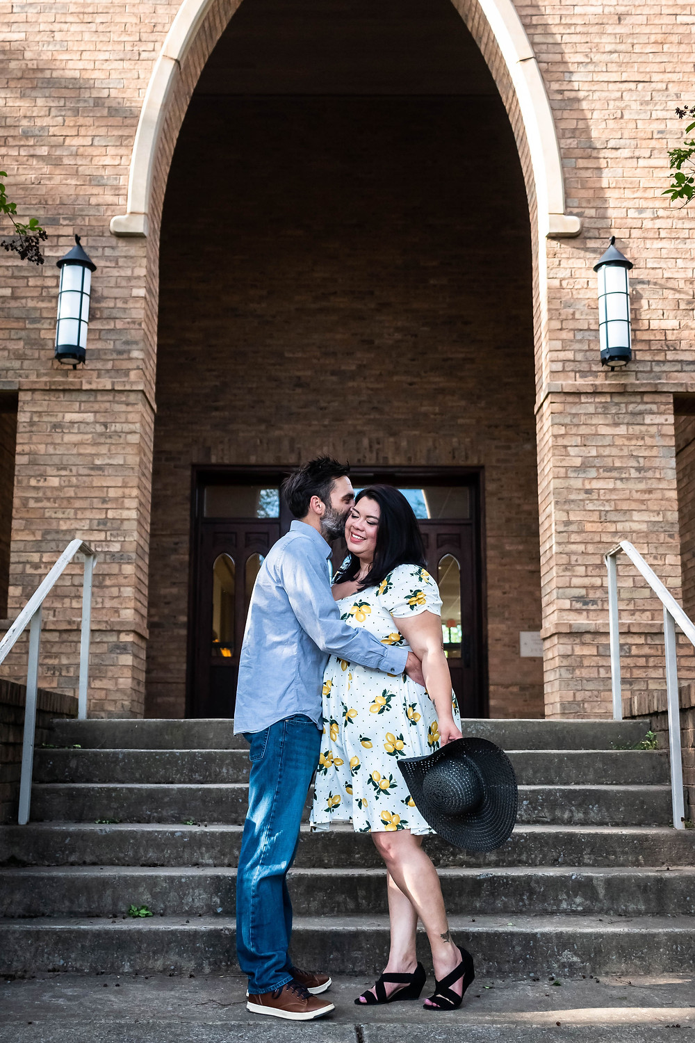 Cute couple share a kiss on the steps of historic church in downtown Murfreesboro