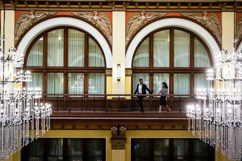 Cute couple walks across hotel balcony at Union Station Hotel