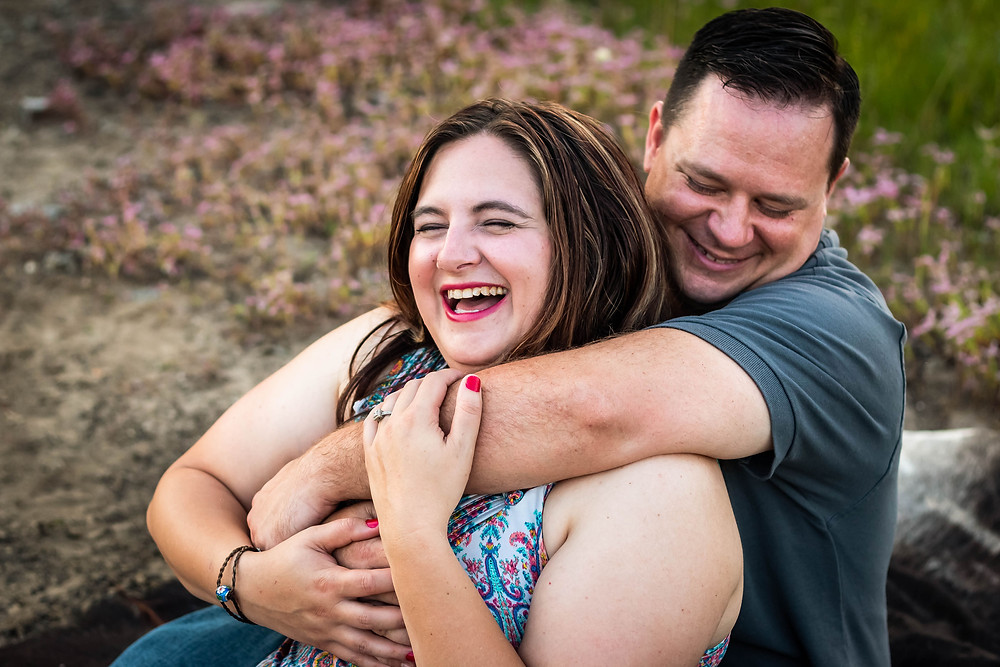 Cute couple snuggled up in a field in Lewisburg, Tennessee