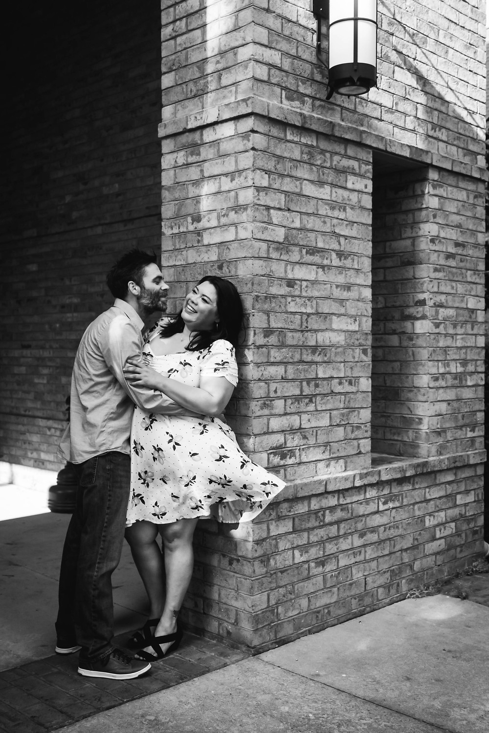 Black and white cute couple goes in for a kiss at historic church in downtown Murfreesboro