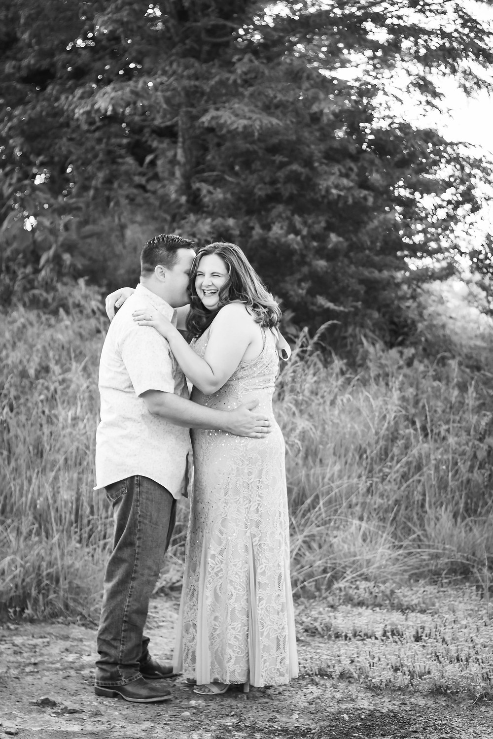 Black and white cute couple laughing in a field in Lewisburg, Tennessee