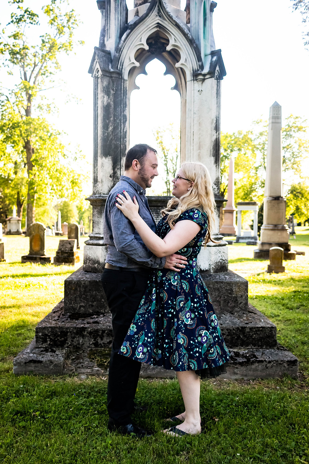 Cute couple facing each other in cemetery at Mt. Olivet Cemetery