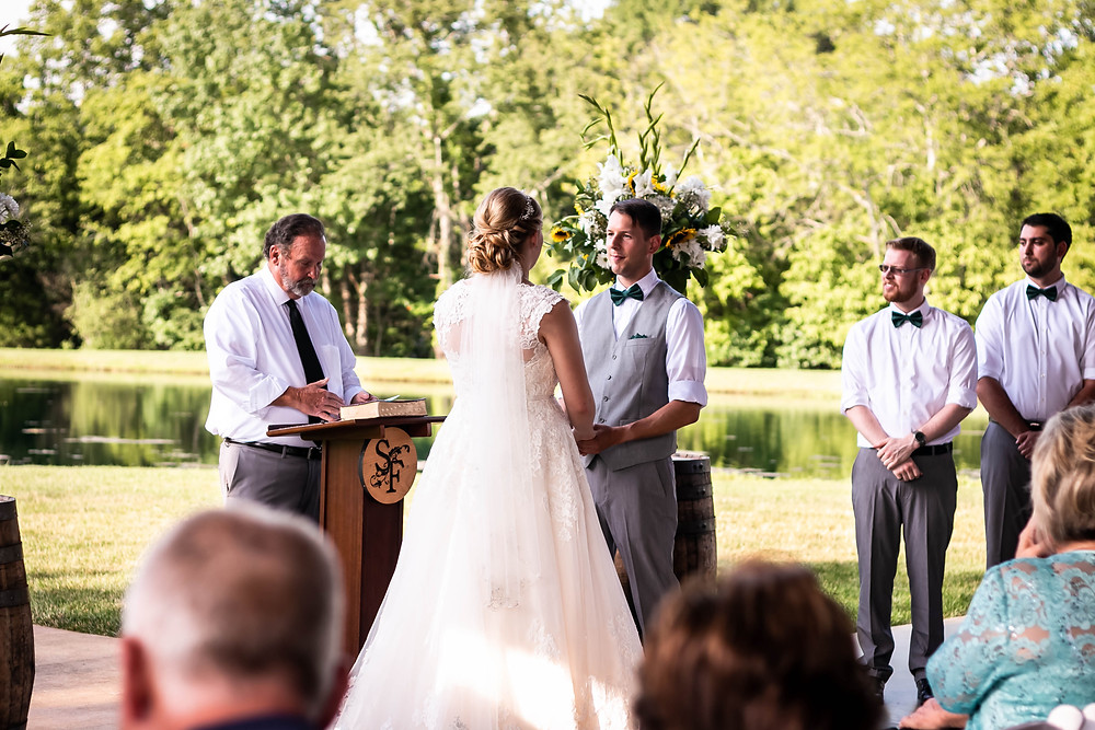 Bride and groom exchange vows at Sycamore Farm