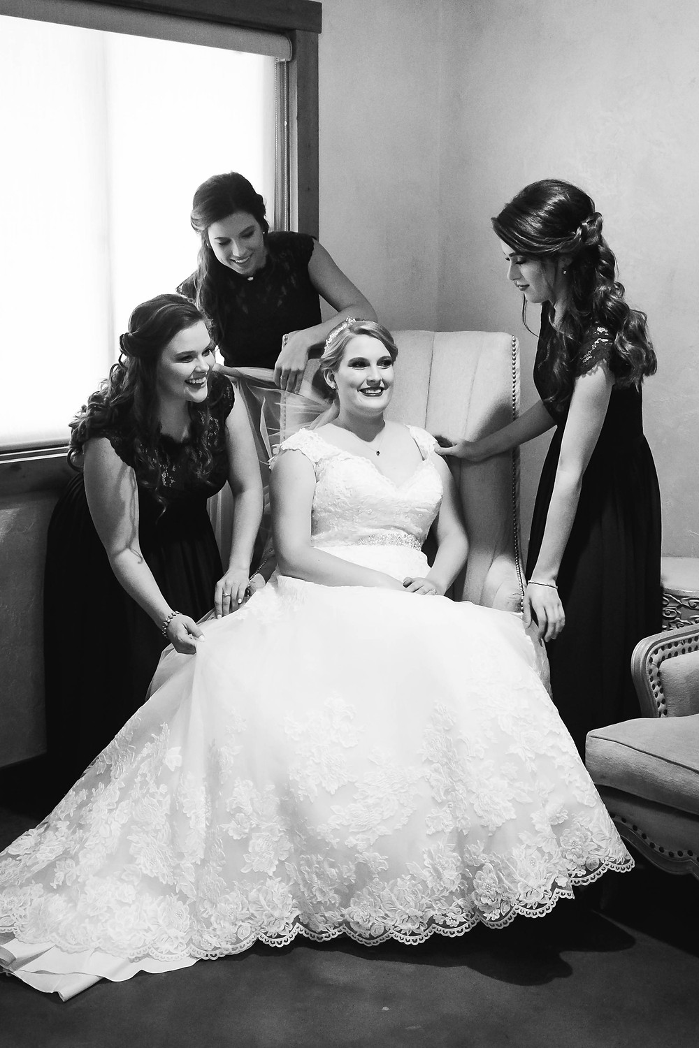 Black and white bride surrounded by bridesmaids at Sycamore Farm