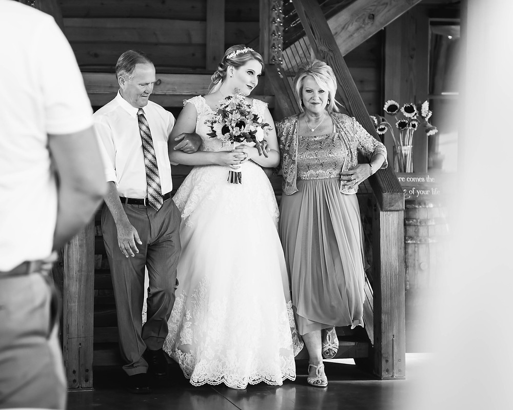 Black and white bride walks down the aisle at Sycamore Farm