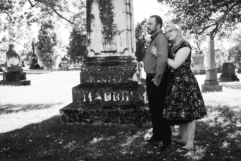 Black and white cute girl rests head on shoulder in cemetery at Mt. Olivet Cemetery