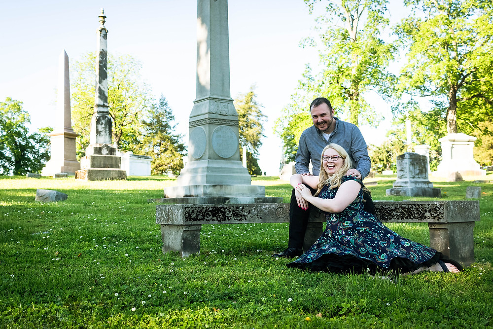 Cute couple seated in cemetery at Mt. Olivet Cemetery