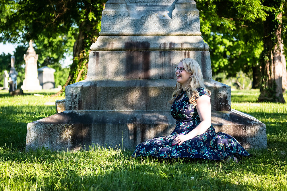 Cute girl sits in cemetery at Mt. Olivet Cemetery