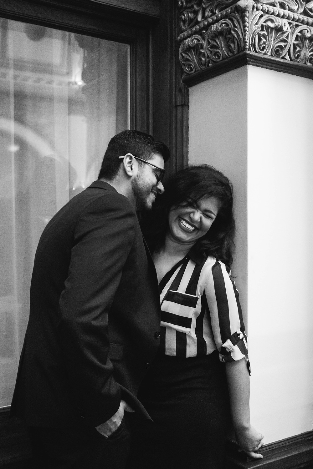 Black and white cute couple goof around in hotel lobby at Union Station Hotel
