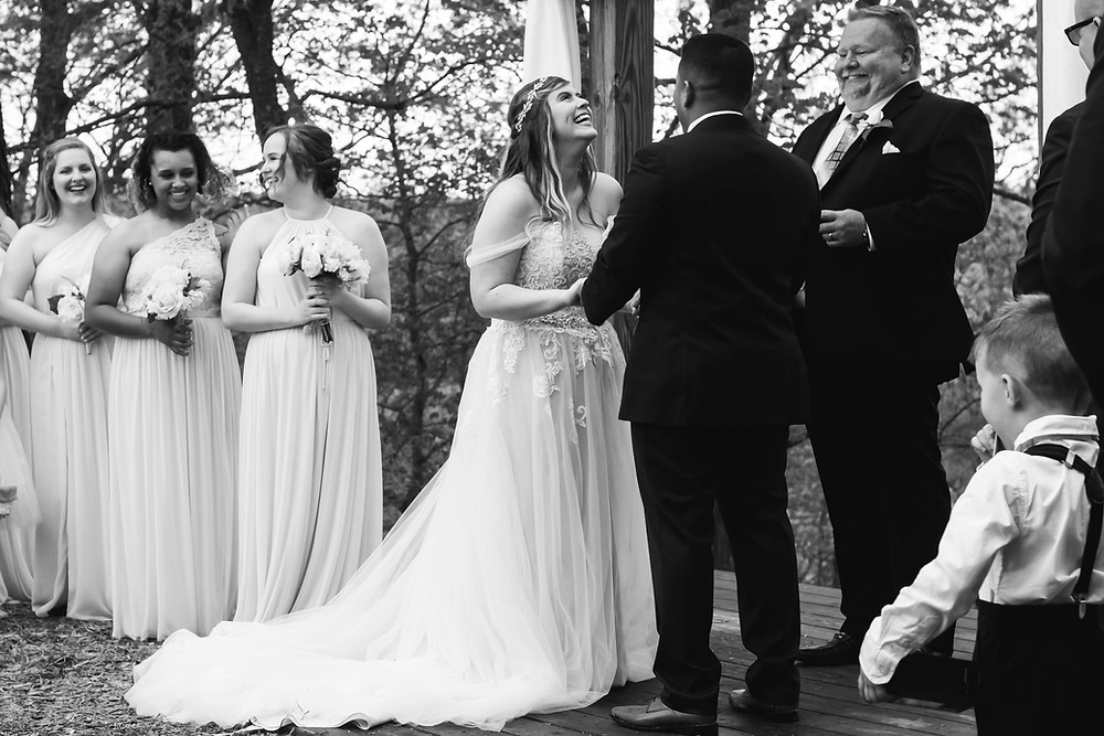 Black and white bride laughs nervously at Owen Farm