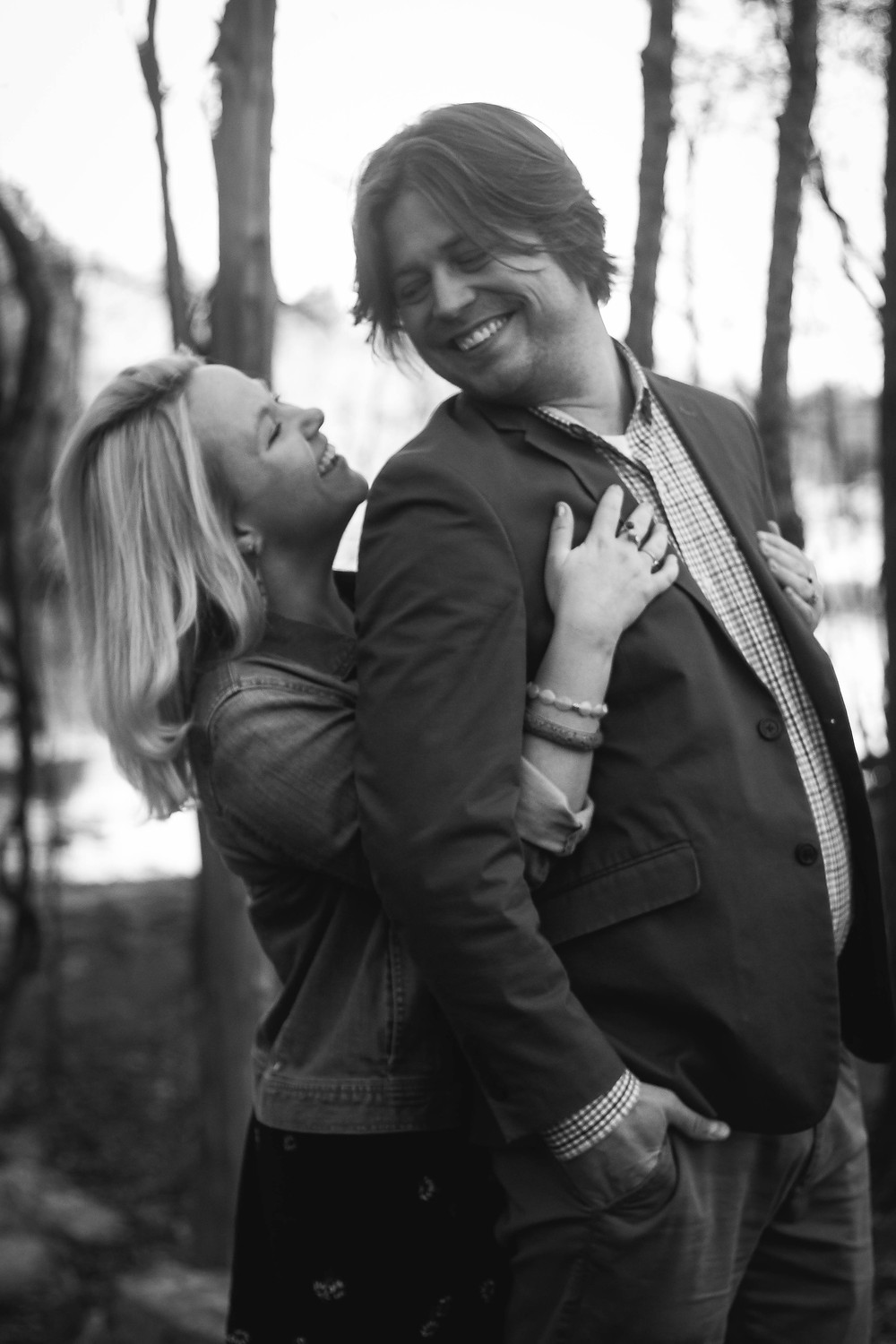 Black and white cute couple share a laugh  at Long Hunter State Park
