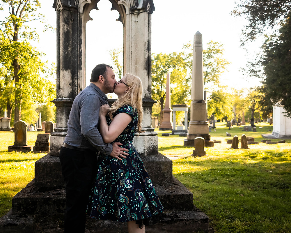 Cute couple share a passionate kiss in cemetery at Mt. Olivet Cemetery