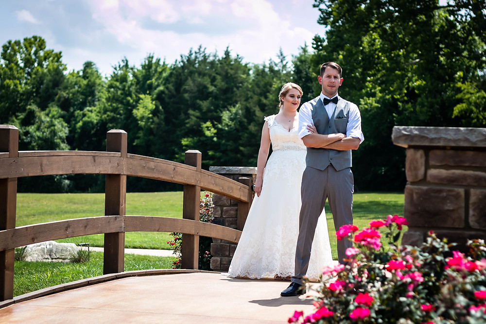 Groom waiting for bride during first look at Sycamore Farm