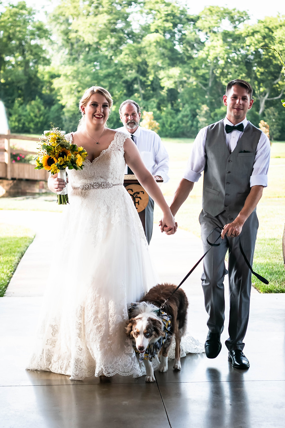 Husband and wife walk down the aisle at Sycamore Farm