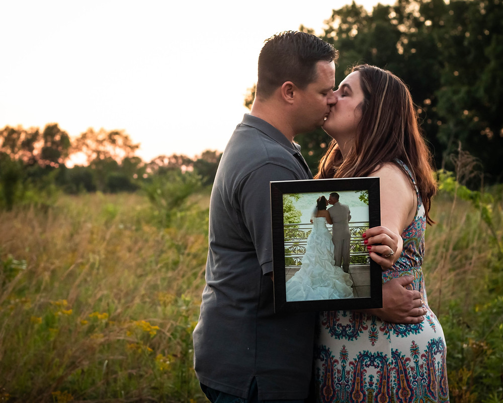 Cute couple kiss with wedding picture in Lewisburg, Tennessee