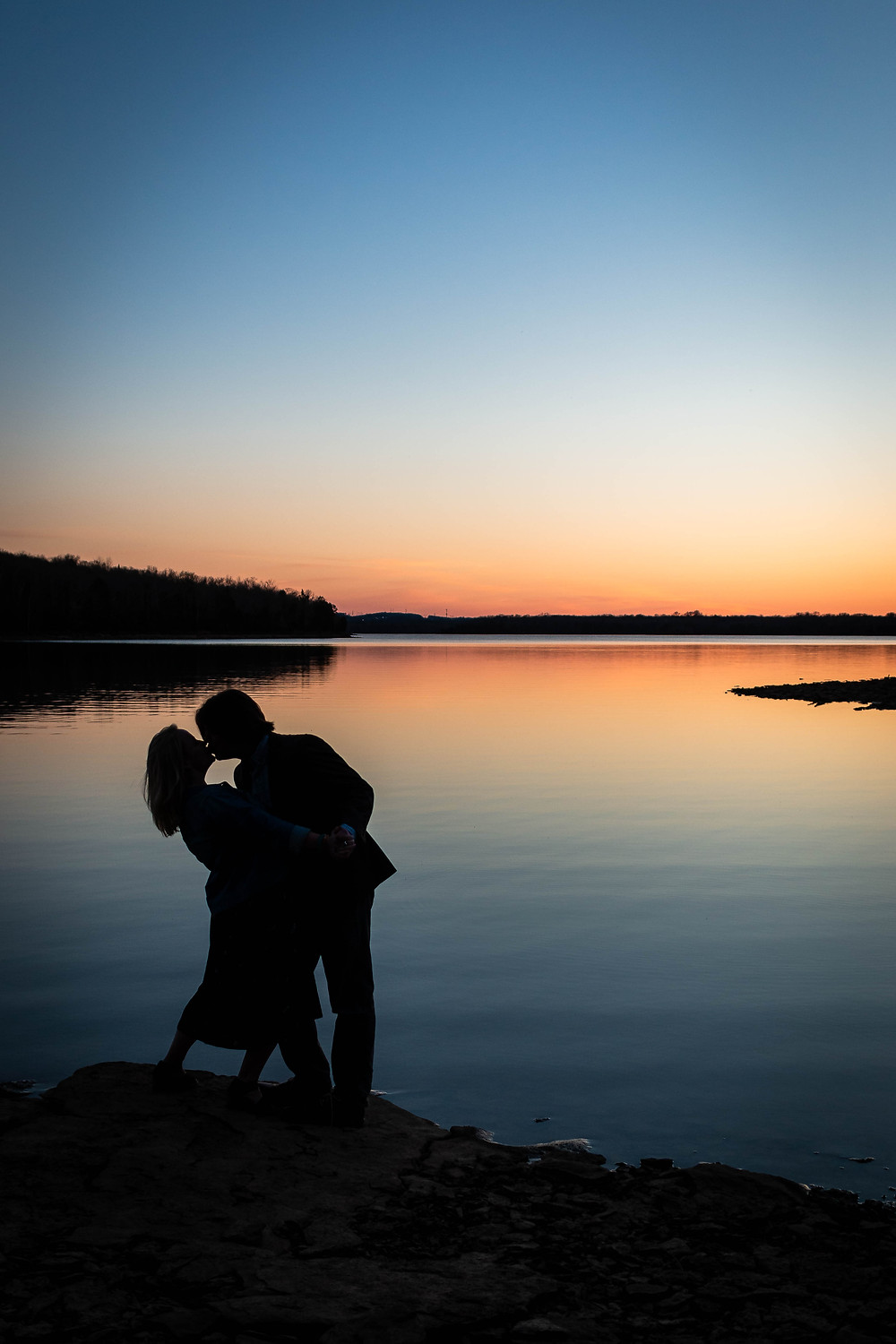 Cute couple kiss at dusk at Long Hunter State Park