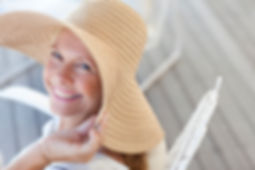 Lady with happy smile and large sunhat.j