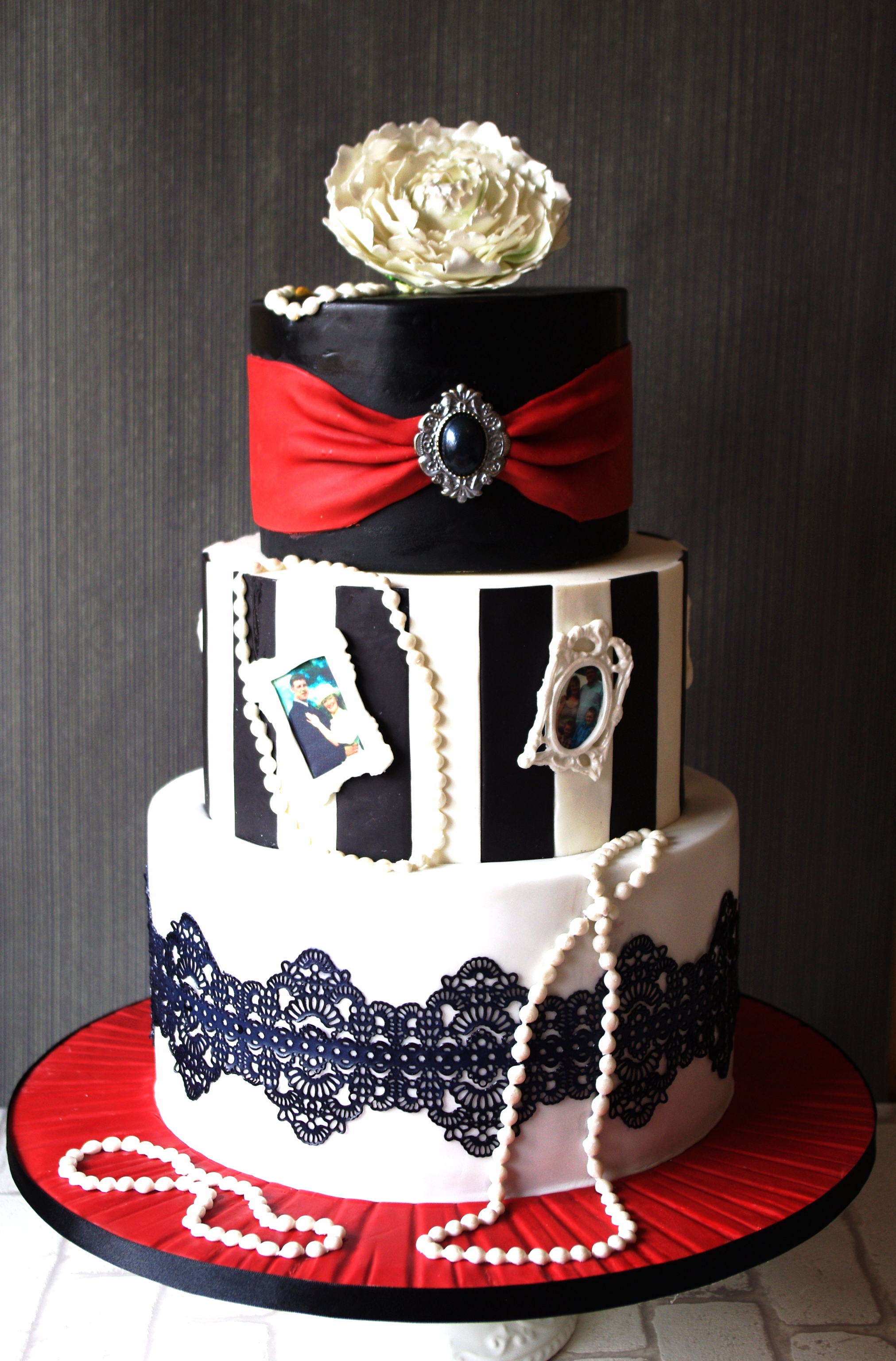Black, white and red striped cake