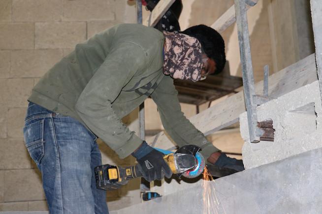 Worker grinding