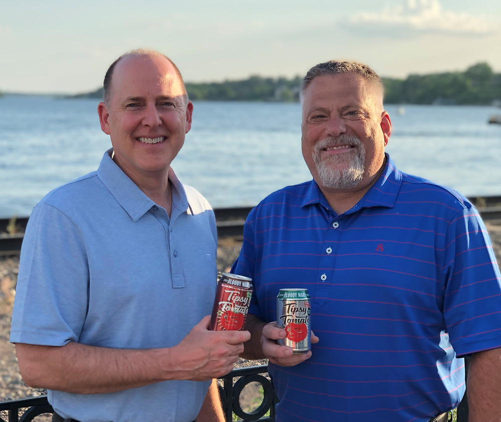 """For Immediate Release June 23, 2021 Ennoble Beverages Announces New President & CFO Beverage Industry Veterans Join Growing FMB Company Reno, NV— June 14, 2021 — Ennoble Beverages, a progressive Ready-to-Drink (RTD) business with Franks Red Hot Bloody Mary ®, Tipsy Tomato Bloody Mary® along with TGIFriday's ® canned cocktails, has added two industry veterans to their growing company. Effective June 1, Jack McCraine was appointed the President of the company along with Scott Ebert as CFO.  """"We are thrilled to have Jack and Scott as part of our team,"""" says Erin Winczura, Chairman and Founder of Ennoble Beverages. """"Their vast knowledge of the complexities of our industry - from manufacturer, distributor and retailer - gives them unique perspectives that are invaluable to our company.""""  Jack McCraine's experience includes many years at Anheuser-Busch InBev in numerous sales and marketing positions before his time at Baker Tilly U.S. where he served as their beverage practice expert. He has worked with clients from all three tiers of the beverage industry as well as other consumer goods companies, manufacturers and distributors.  When asked about his new role Jack said, """"I am excited to join the Ennoble team and work alongside this group of talented professionals who are passionate about creating new beverages that address the changing consumer needs. Our distributor network is impressive, spanning more than 40 states and growing. I look forward to leveraging our collective talents between our internal team of veterans and longtime friends at our distributor partners to achieve remarkable results.""""  Scott Ebert will provide financial leadership and business development strategy while helping to grow and manage Ennoble's portfolio of brands. He has 35 years of experience managing clients and assisting them while growing their businesses.  After leaving Baker Tilly, he joined Three Floyd's Brewing, and WarPigs Brewing USA, as their Chief Business Development and Financial """
