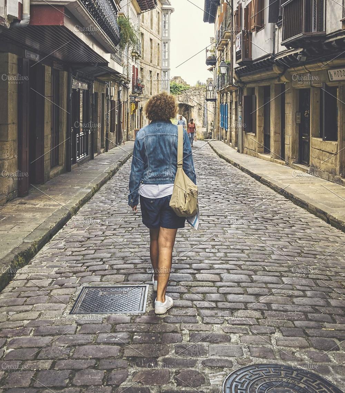 Woman Walking Down a Street