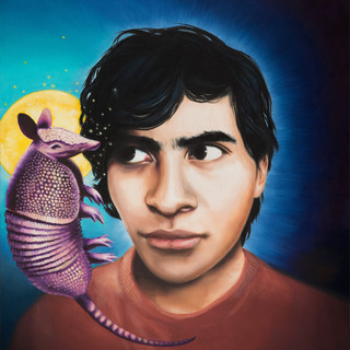 Portrait of Diego with a baby armadillo