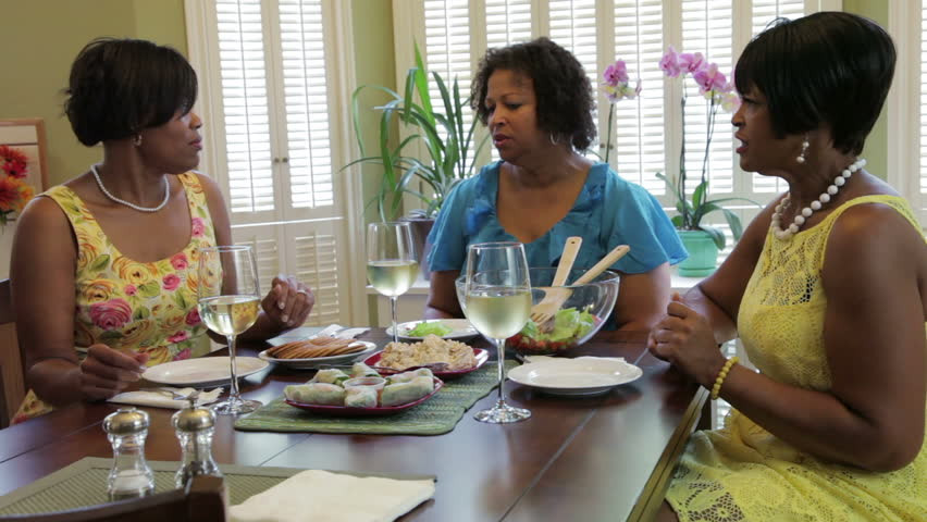 Caregiver discussing topic while enjoying a meal