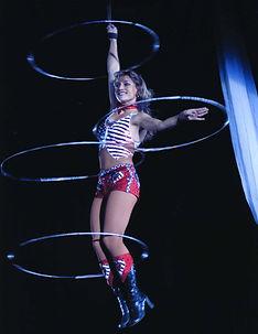 flying hoops, hula hoops in the air, aerial hooping