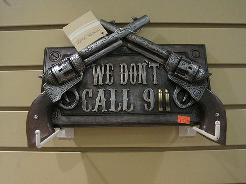 We Don't Dial 911 Sign with Two Guns