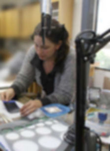 Camille Torres at work in jewelry studio.