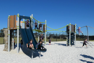 Perth School Playground Supplier. Nature Inspired Playbooster with slide. Natureplay. Netplay. Climbing.