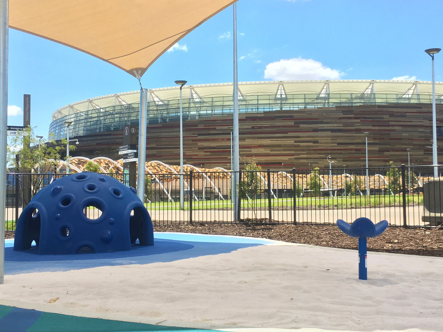 Optus Stadium Perth. Playground by Dynamic Playgrounds. Cozy Dome and Saddle Spinner.