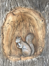 Handcarved Squirrel. Perth Playgrounds Supplier. Treehouse Nature Inspired Playground