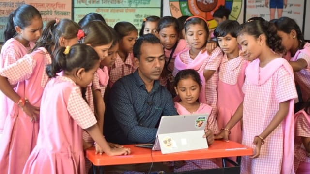 Ranjitsinh Disale who won the Global Teacher Prize for most exceptional teacher surrounded by his students