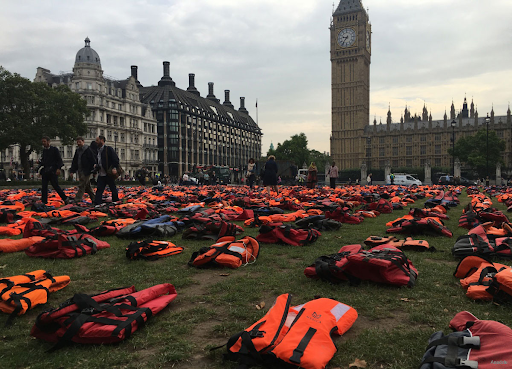 Life jackets outside the houses of parliament to represent people who have died trying to get to the UK across the Channel
