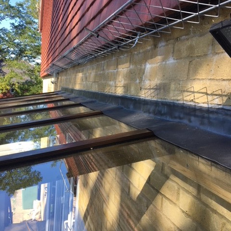 wood canopy flashing with snow guard