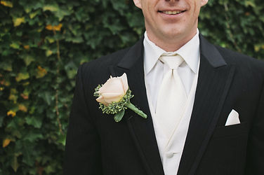 man-in-black-formal-suit-with-white-neck