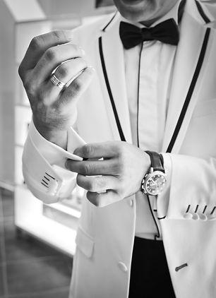 man-wearing-tuxedo-in-grayscale-photogra