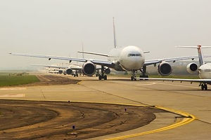 Commercial aircraft on a runway on an overcast day