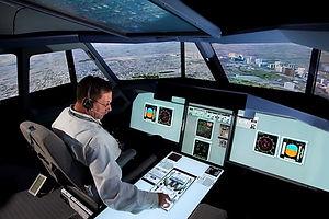 Cockpit simulation facility Expert sitting inside of a simulator