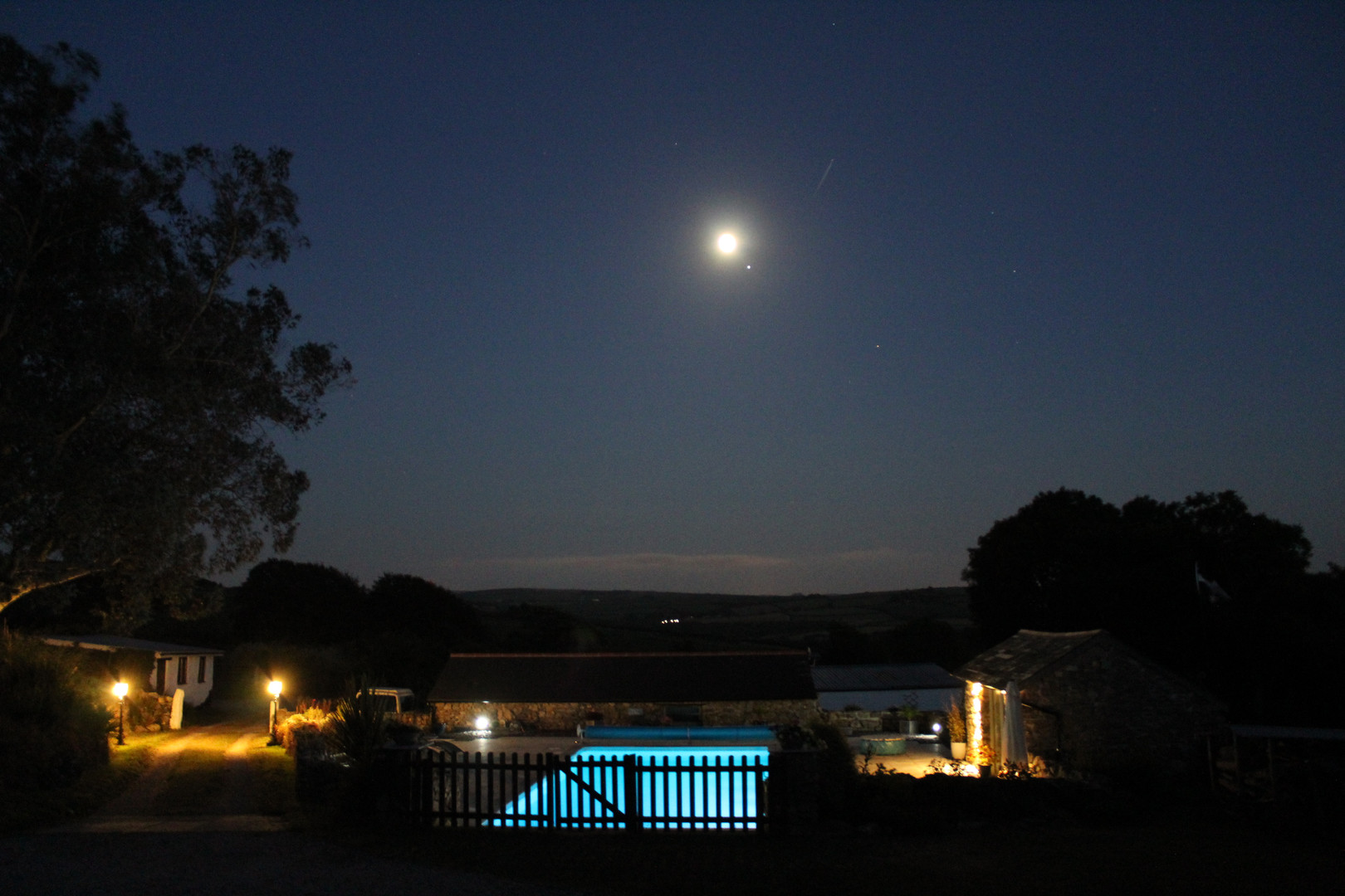 Moon and Jupiter over the pool