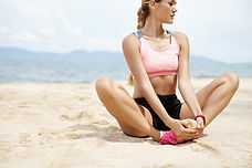 Girl Stretching on Beach
