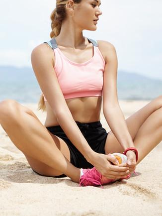 Girl Stretching on Beach