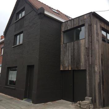 Schilder je façade en steek je huis in een nieuw jasje.