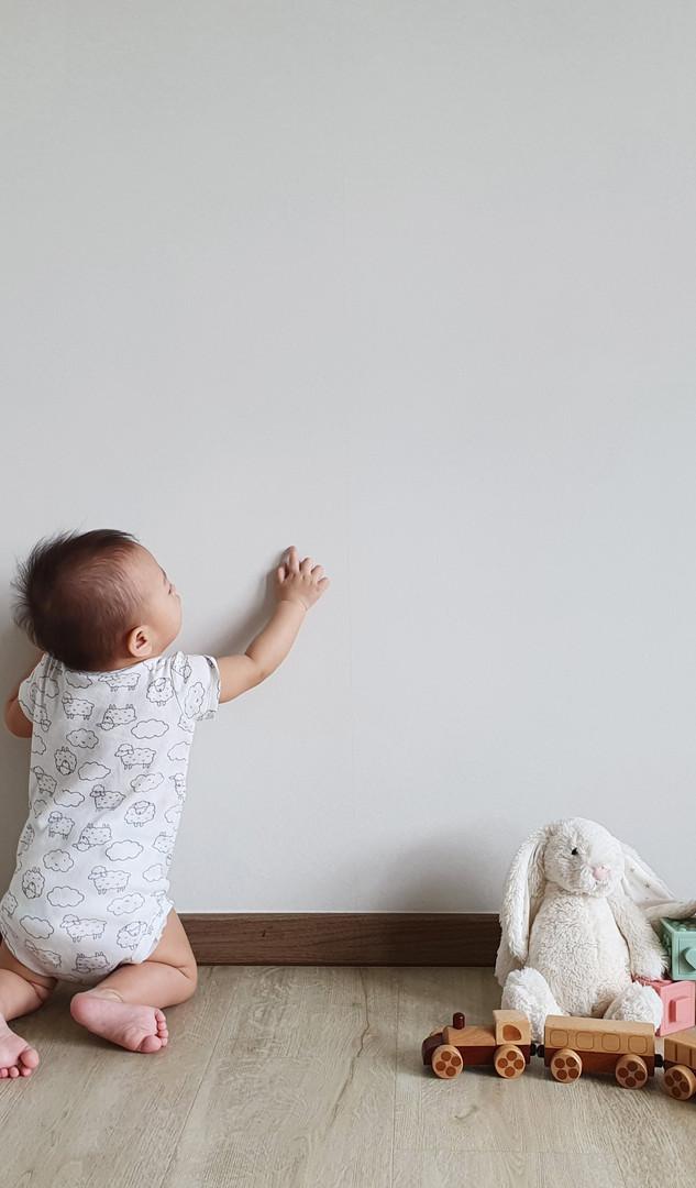 Baby touching Lonprotect wallpaper.jpg