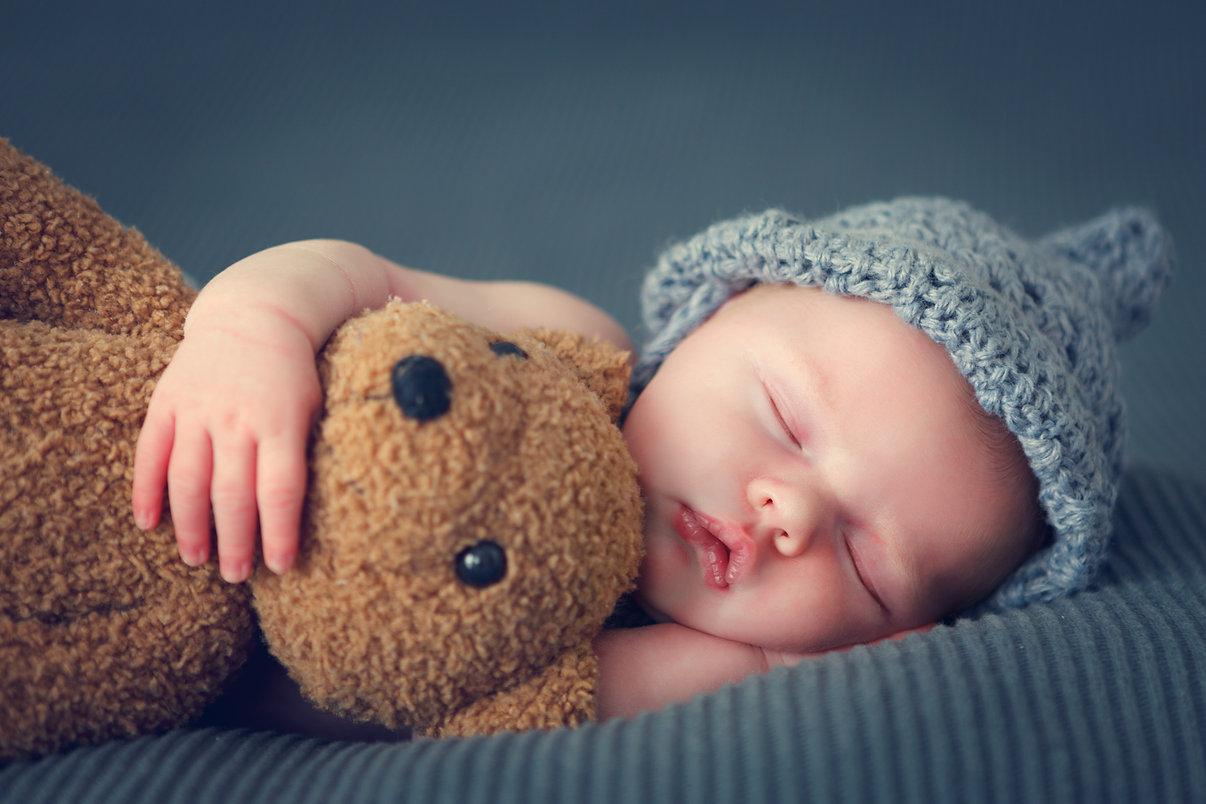 sleeping newborn baby on a blanket with