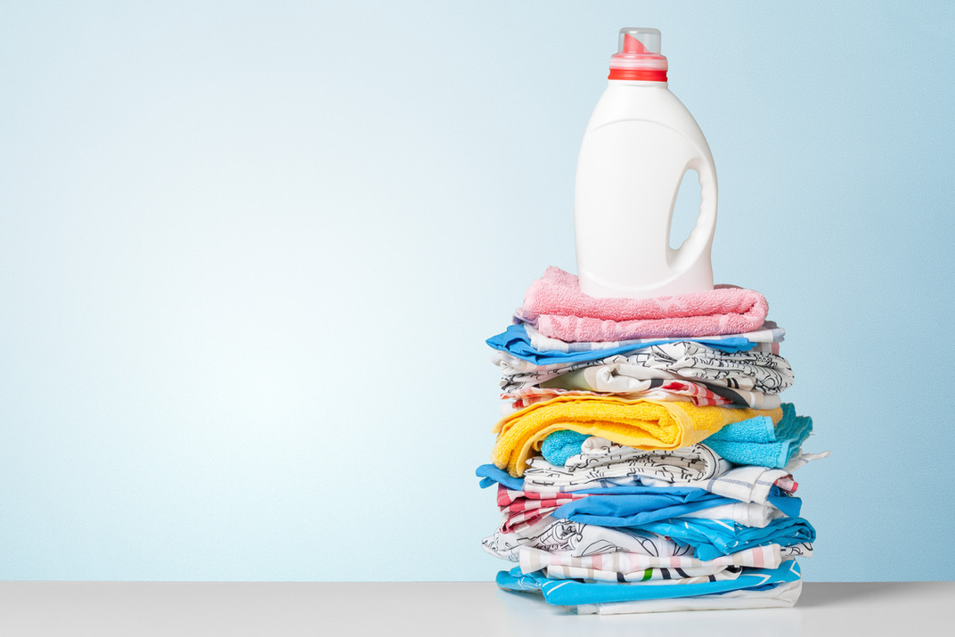 Colorful towels and liquid laundry deter