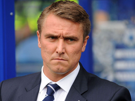 Lee Clark questions the players during their warm ups